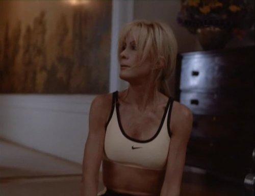 Joan Van Ark in sports bra